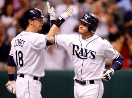 Tampa Bay Rays' Evan Longoria, right, is congratulated by Ben Zobrist after Longoria hit a home run in the fifth inning of a baseball game against the New York Yankees Tuesday, July 28, 2009, in St. Petersburg, Fla. (AP Photo/Mike Carlson)